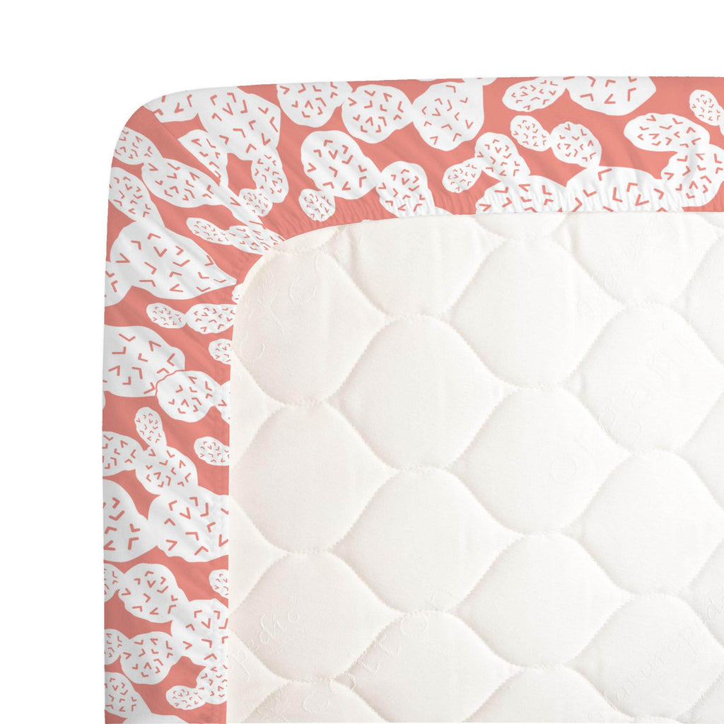 Product image for Light Coral Prickly Pear Crib Sheet