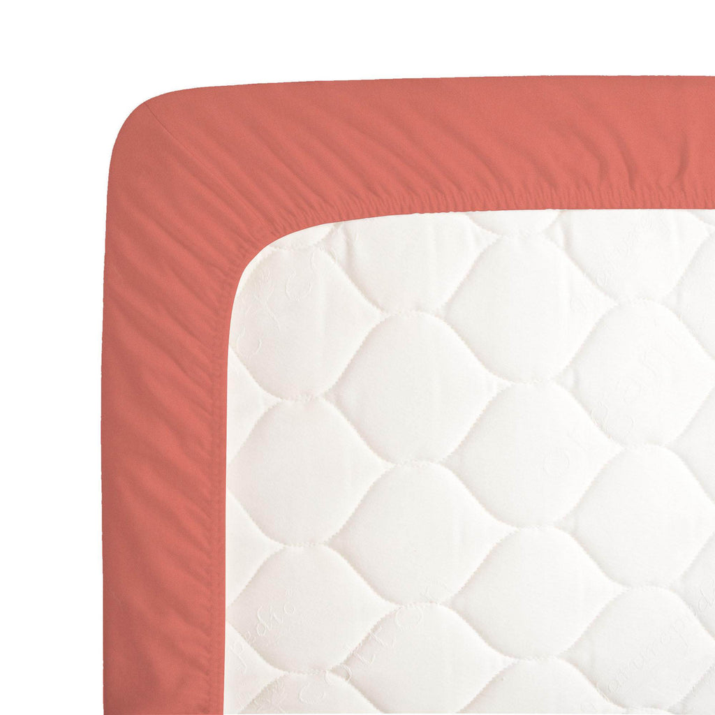 Product image for Solid Coral Crib Sheet