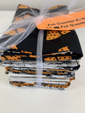A fun group of Halloween fat quarters with cats, sewing accessories, mannequins and more.