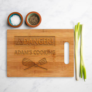 Personalised square 'Danger Cooking' chopping board
