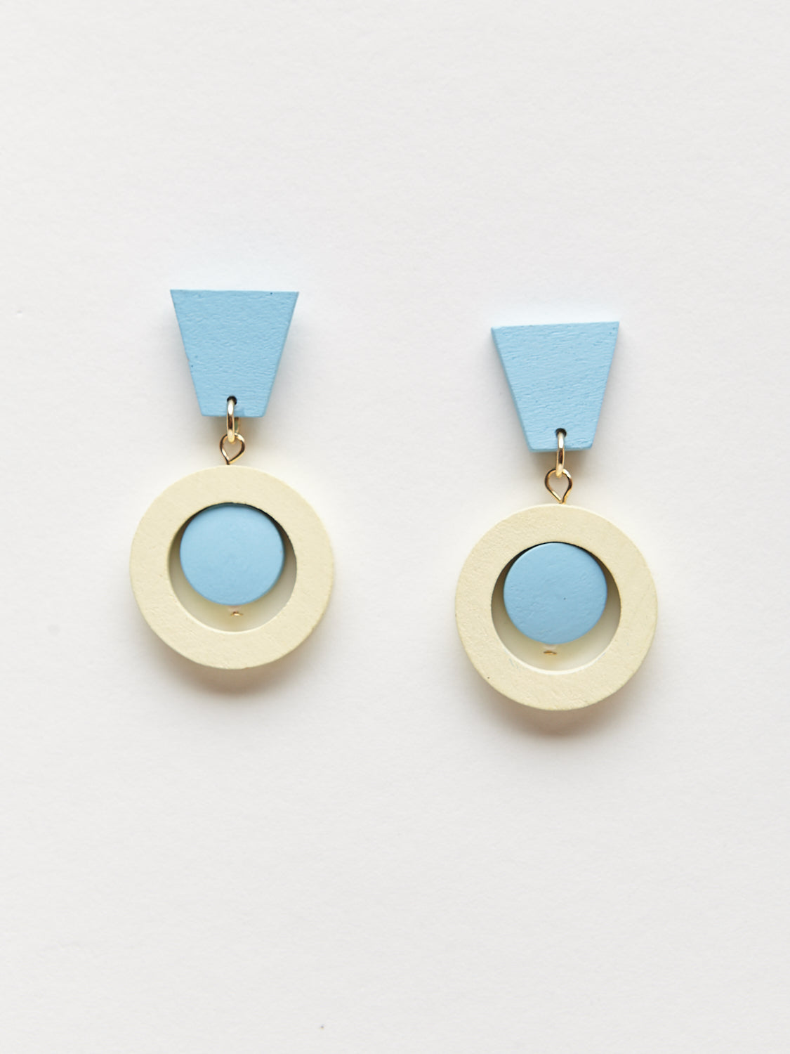 Detail shot of blue and white geometric dangling earrings