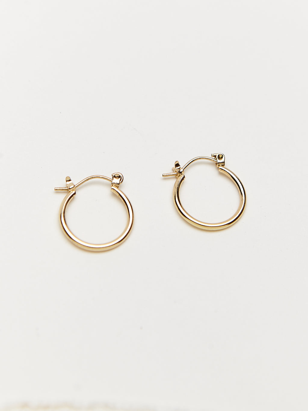 Detail shot of gold hoop earrings