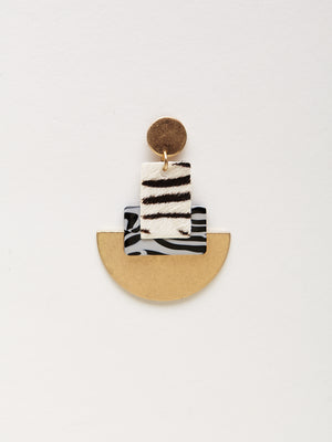 detail photo of zebra printed statement earrings