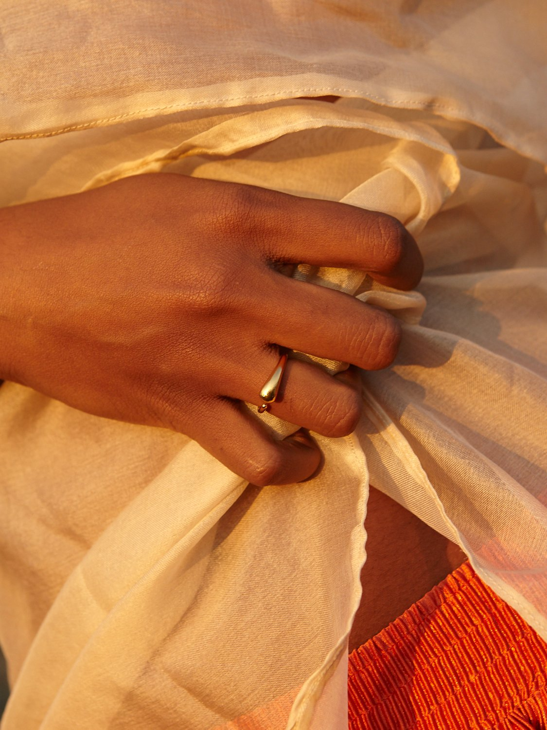 hand model wearing gold ring