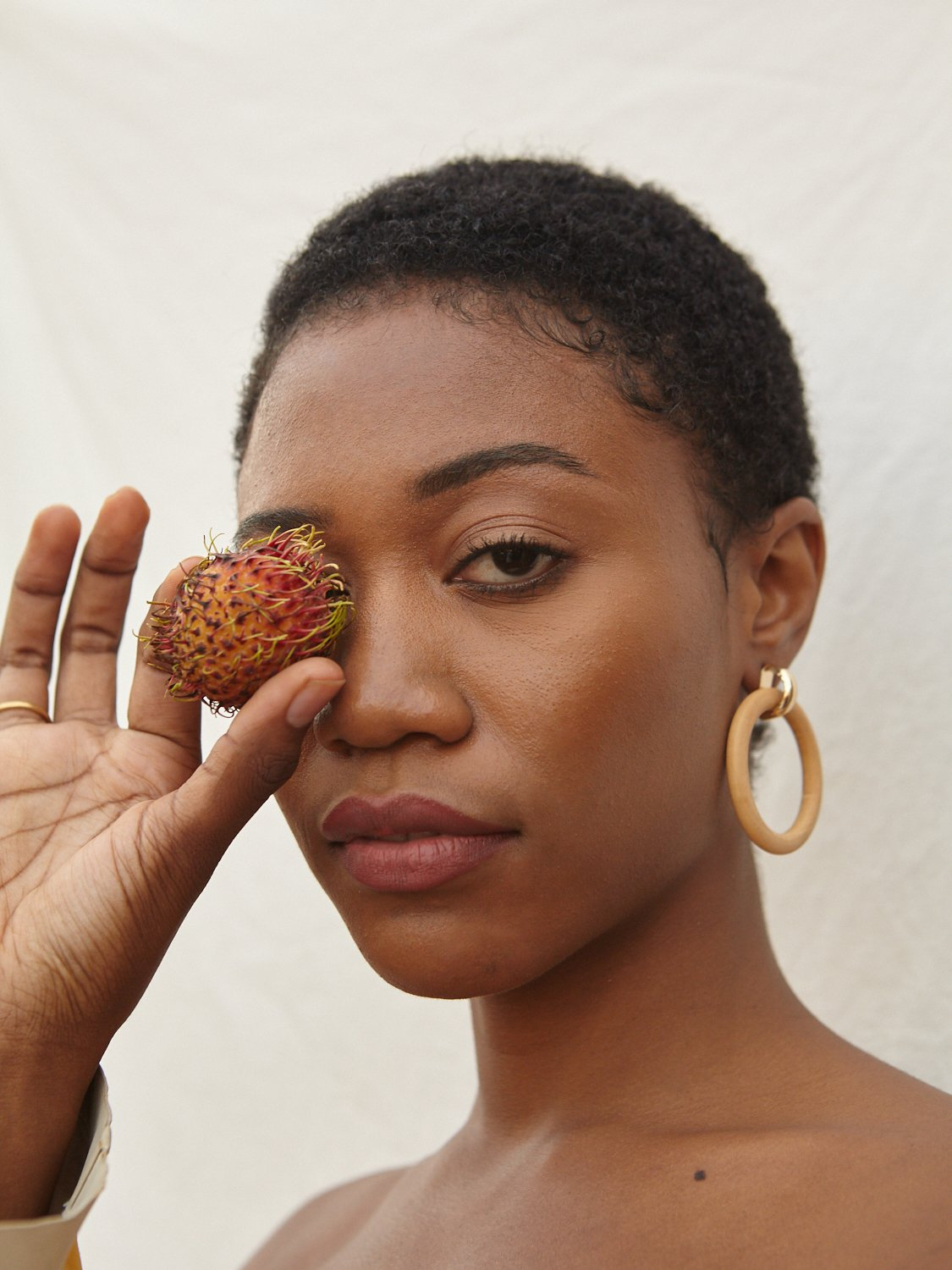 model wearing wooden hoop earrings