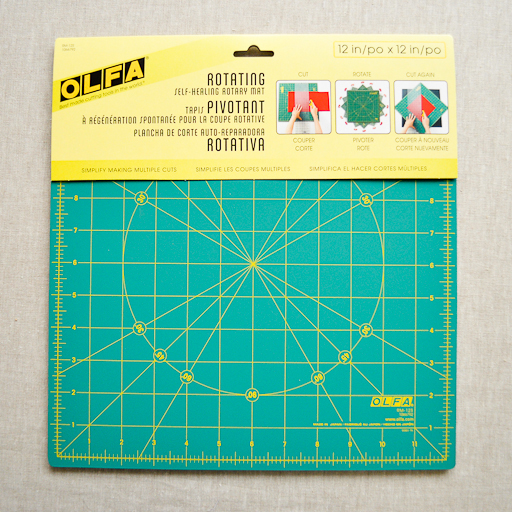 "Olfa : Cutting Mat : 12"" x 12"" Rotating Self-Healing Rotary Mat"