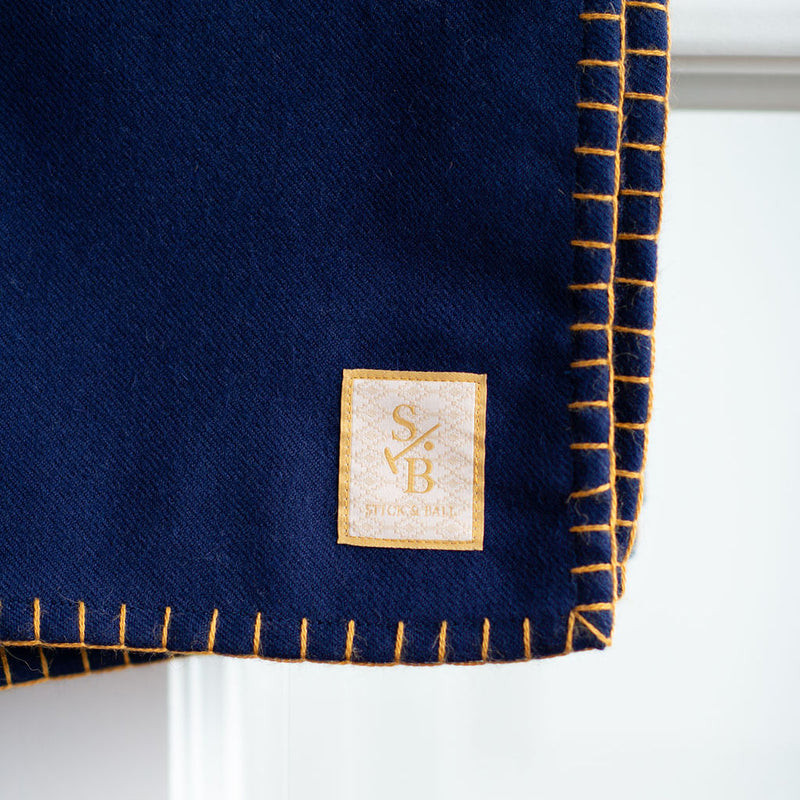 Loom & hand-stitched Navy Alpaca Throw with Gold Stitch - Stick & Ball label