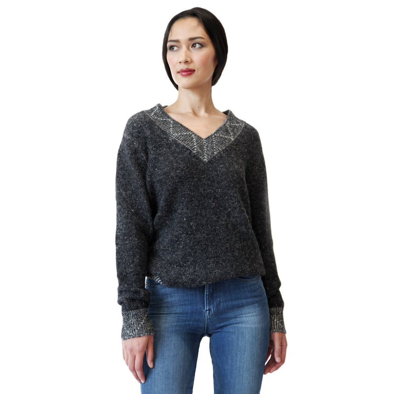 Woman wearing alpaca v-neck charcoal grey sweater