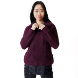 Woman wearing burgundy alpaca cowl neck sweater