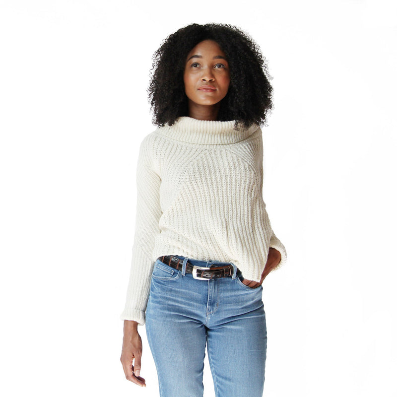 Woman wearing cream alpaca cowl neck sweater