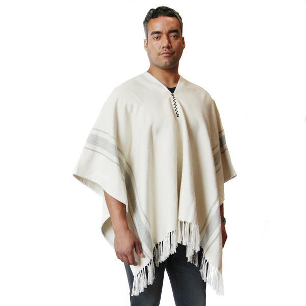 Man wearing Handwoven Camilo Alpaca Poncho with Fringe - Stick & Ball