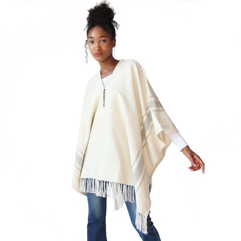 Woman wearing Handwoven Camilo Alpaca Poncho with Fringe - Stick & Ball