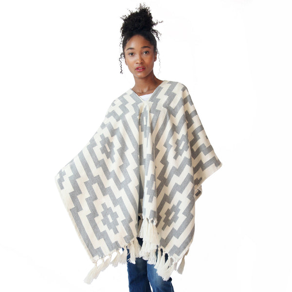 Woman wearing Handwoven Gaucho Pampa Alpaca Poncho with tassels - Light Grey & Ecru - Stick & Ball