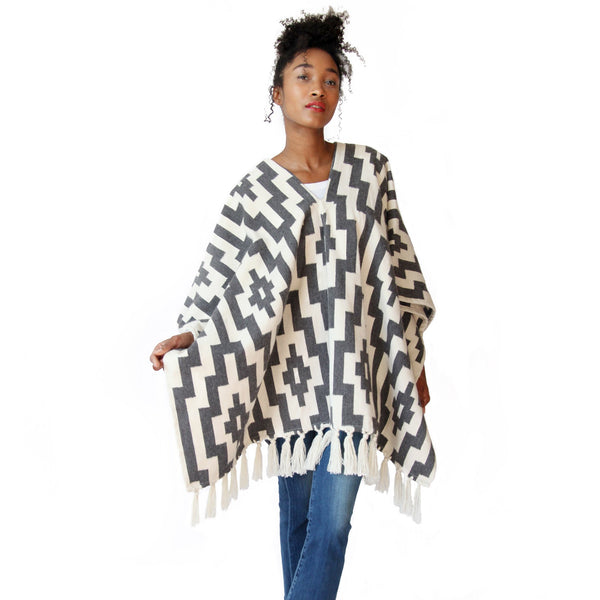 Woman wearing Handwoven Gaucho Pampa Alpaca Poncho with tassels - Charcoal & Ecru - Stick & Ball