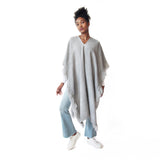 Woman wearing Handwoven Long Fringed Alpaca Poncho in Light Grey - Stick & Ball