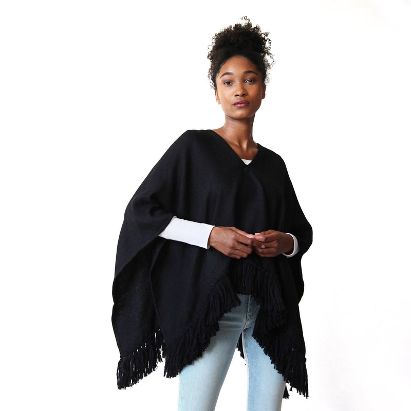 Woman wearing Handwoven Cropped Fringe Alpaca Poncho with fringe - Black - Stick & Ball