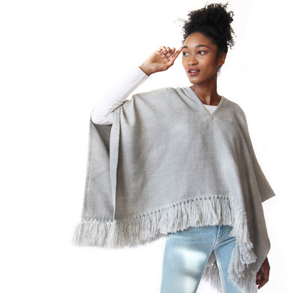 Woman wearing Handwoven Cropped Fringe Alpaca Poncho with fringe - Light Grey - Stick & Ball