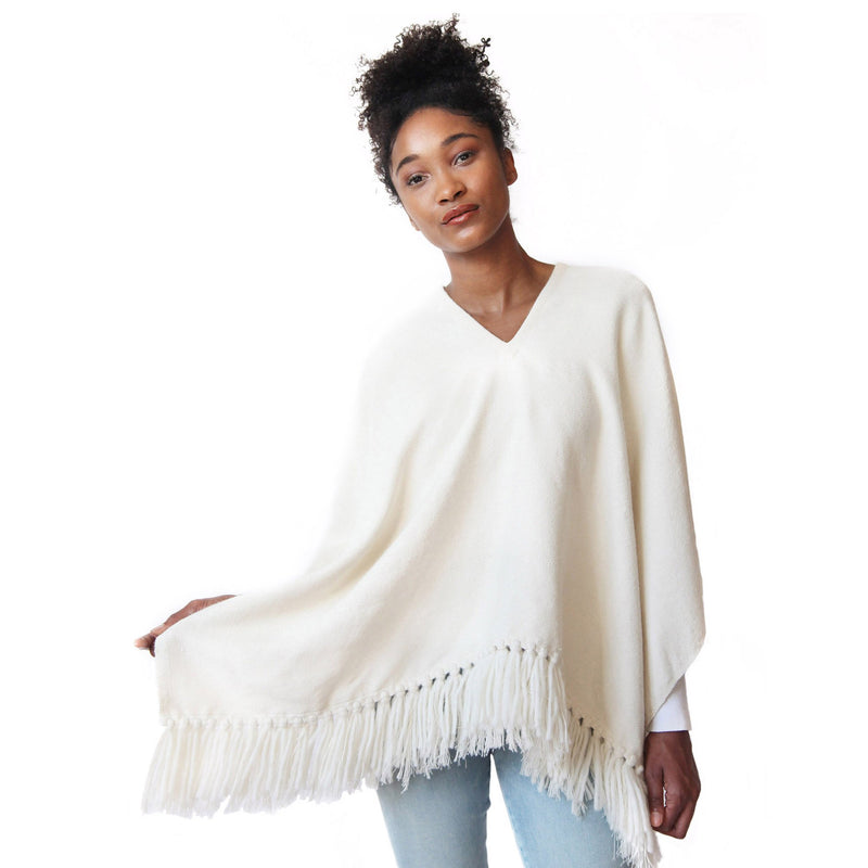 Woman wearing Handwoven Cropped Fringe Alpaca Poncho with fringe - Winter White/Cream, Stick & Ball