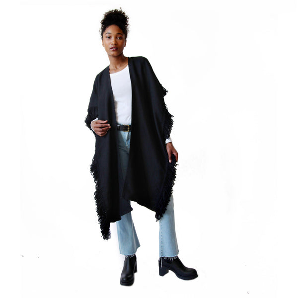 Woman wearing Black Handwoven Alpaca Fringed Ruana Wrap open - Stick & Ball