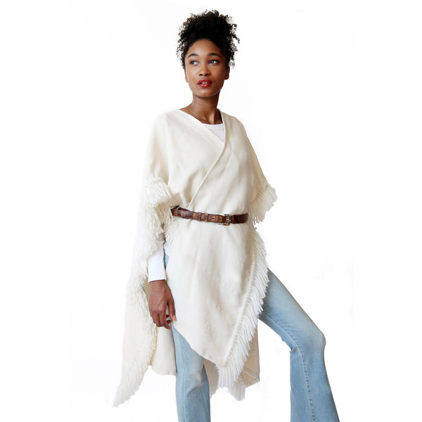 Woman wearing Winter White/Cream Handwoven Alpaca Fringed Ruana Wrap closed/belted  - Stick & Ball