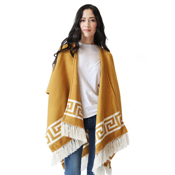 Woman wearing Handwoven Inca Gold Alpaca Ruana/Wrap with tassels - Stick & Ball