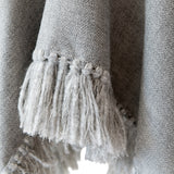 Herringbone hand-weave and hand-tied details of Long Fringed Alpaca Poncho, Light Grey Stick & Ball