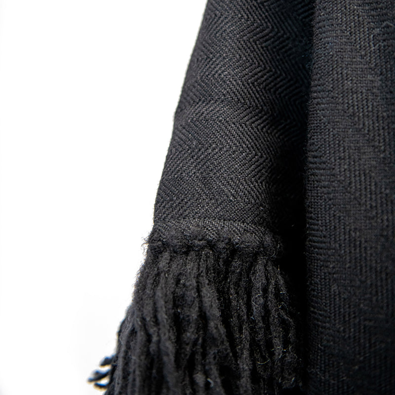 Herringbone hand-weave and hand-tied details of Long Fringed Alpaca Poncho in Black - Stick & Ball