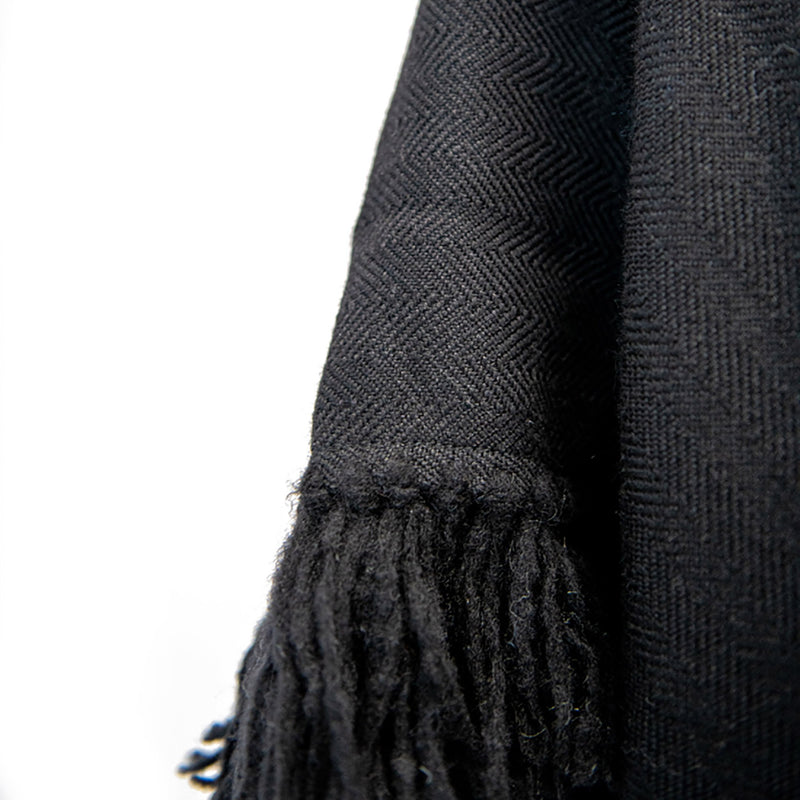 Herringbone hand-weave and hand-tied fringe from Cropped Fringe Alpaca Poncho - Black - Stick & Ball