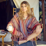 Woman wearing Handwoven Blanket Striped Alpaca Pampa Poncho with geometric patterns - Stick & Ball