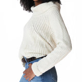 Woman wearing cream alpaca cowl neck sweater side view