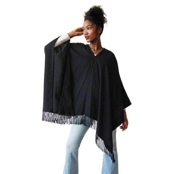 Woman wearing Handwoven Blackout Pilar Alpaca Poncho with fringe - Stick & Ball