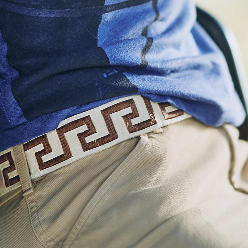 Woman wearing Hand-stitched Argentine Inca Polo Belt White Rawhide with Copper Stitch - Stick & Ball