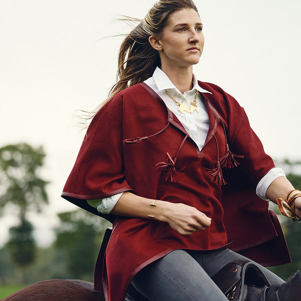 Woman wearing Brass Polo Mallet, Caballos Besando Necklace & Leather Trim Alpaca Poncho in Burgundy