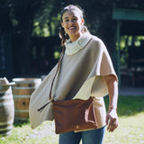 Woman wearing handmade Vegetable-tanned deerskin leather Indio Crossbody bag in brown Stick & Ball