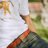 Woman wearing Hand-stitched Argentine Inca Polo Belt - Tan leather with Coral Stitch - Stick & Ball