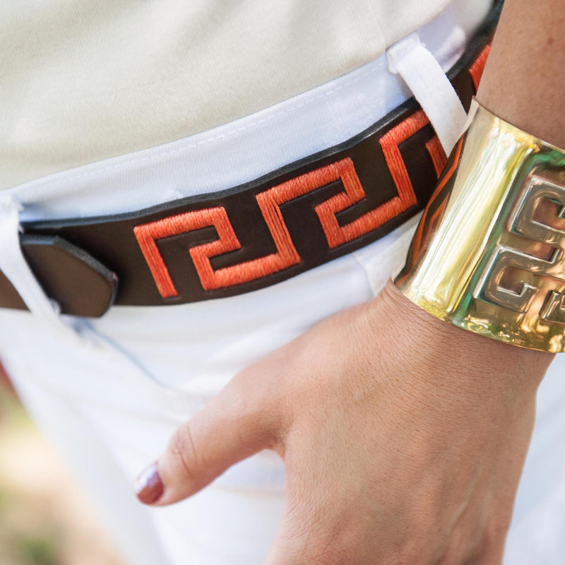 Woman wearing Hand-stitched Argentine Inca Polo Belt in Dark Brown leather with Coral Stitch
