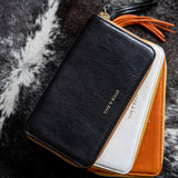 Stack of handmade vegetable-tanned Italian leather Zip/Clutch Wallets - Black, White, Orange