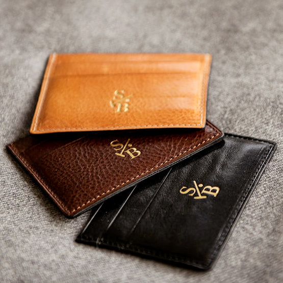 Double sided flat wallets in tan brown and black