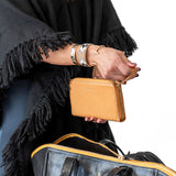 Woman unzipping handmade vegetable-tanned Italian leather Zip/Clutch Wallet in Tan - Stick & Ball
