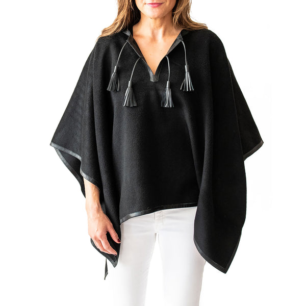 Woman wearing Italian Leather Trim Tassel Alpaca Poncho - Black, front side - Stick & Ball