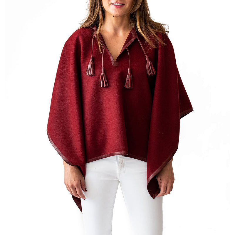 Woman wearing Italian Leather Trim Tassel Alpaca Poncho - Burgundy, front side - Stick & Ball