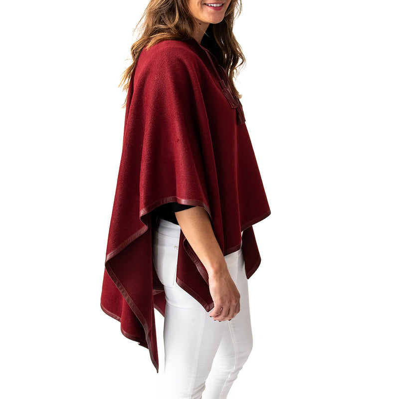 Woman wearing Italian Leather Trim Tassel Alpaca Poncho - Burgundy, side view - Stick & Ball