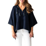 Woman wearing Italian Leather Trim Tassel Alpaca Poncho - Navy, front side - Stick & Ball