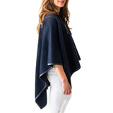 Woman wearing Italian Leather Trim Tassel Alpaca Poncho - Navy, side view - Stick & Ball
