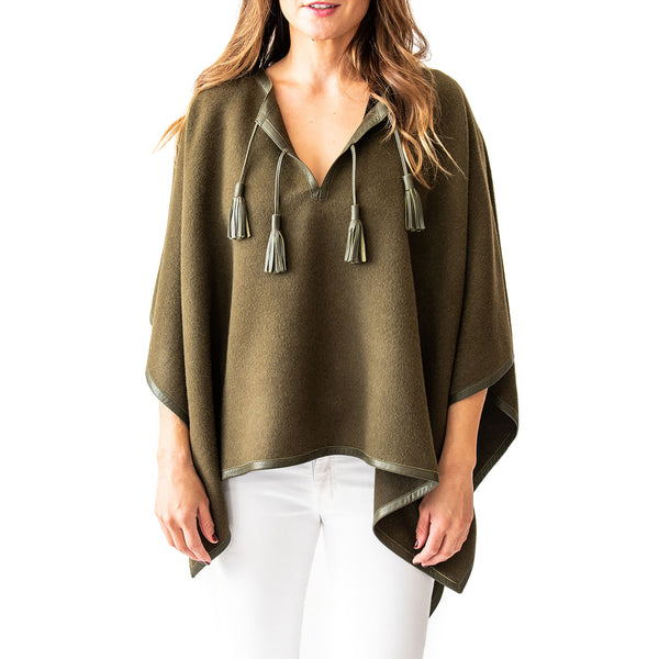 Woman wearing Italian Leather Trim Tassel Alpaca Poncho - Olive, front side - Stick & Ball
