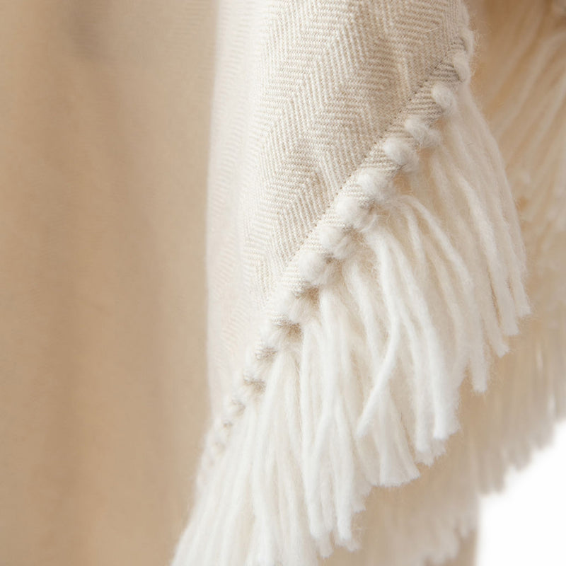 Herringbone hand-weave and hand-tied details of Long Fringed Alpaca Poncho, Winter White