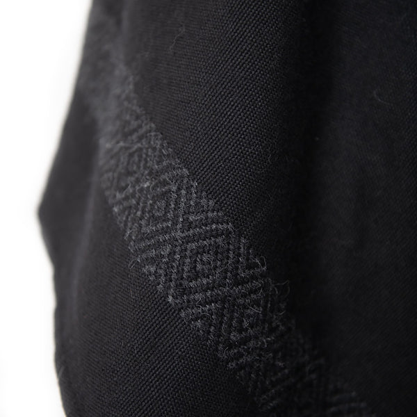 Design details of Handwoven Blackout Pilar Alpaca Poncho with Fringe - Stick & Ball