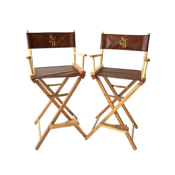 Two Bar Height Director's Chairs, leather with gold embroidered Stick & Ball Logo
