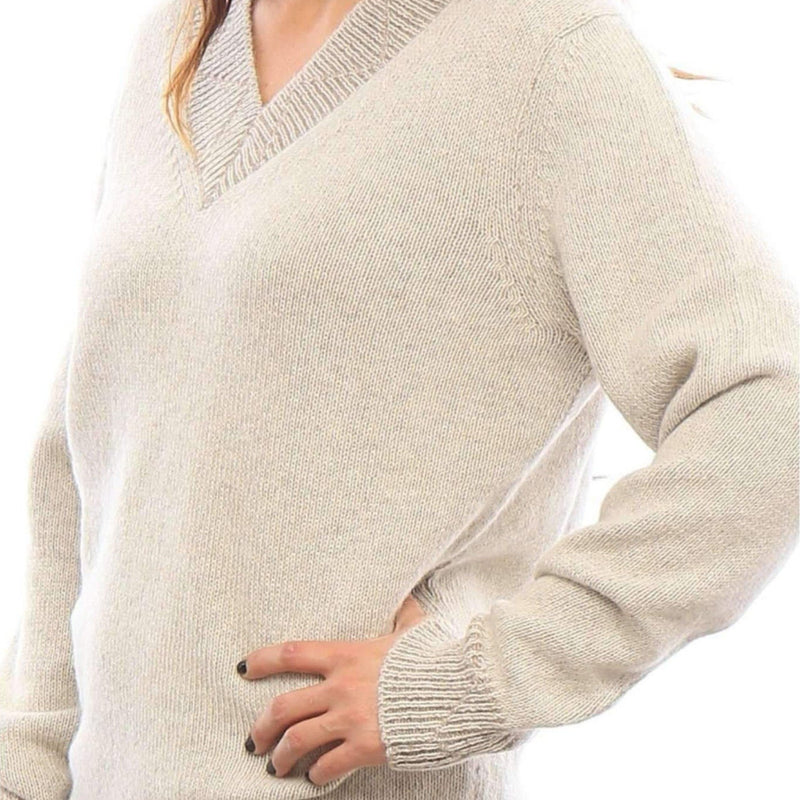 Woman side view oatmeal alpaca v-neck sweater - Stick & Ball