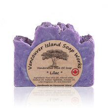 Load image into Gallery viewer, One sniff of this bar and I'm transported back to my childhood and the lilac tree growing outside our kitchen window. This true lilac scent is a favourite among flower lovers. Handmade, natural, vegan, olive oil soap. Made on Vancouver Island in BC, Canada.